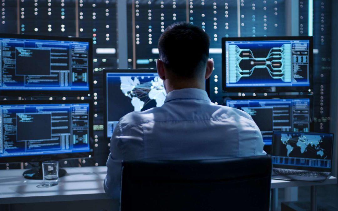man sitting at computer